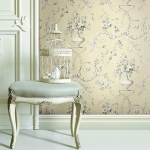 Upholstered stool with ornate bird cage an white dove decorations on a panelled wall